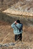 Man using binoculars outdoors Royalty Free Stock Images