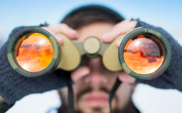 Man using binoculars outside on a winter day Stock Photography