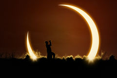 Man using binoculars to watch solar eclipse Stock Image