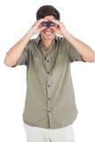 Man using binoculars Stock Images