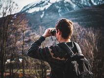 Man Using Black Binoculars Near Forest Trees at Daytime royalty free stock image