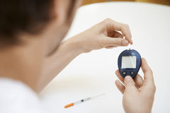 Man Using Blood Sugar Meter stock images