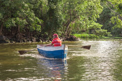 Man using a boat on river from Nicaragua Royalty Free Stock Photo