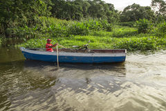 Man using a boat on river from Nicaragua Stock Images