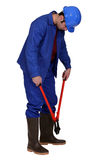 Man using bolt cutters Royalty Free Stock Image