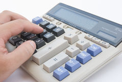 Man using a calculator Stock Image
