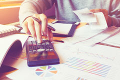 Man using calculator and calculate cost with holding bill in hom Royalty Free Stock Photography