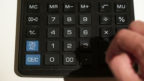 Man using calculator. Closeup on white background stock footage