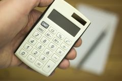 Man using calculator to count income and outcome Stock Images