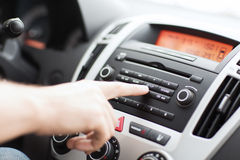 Man using car audio stereo system. Transportation and vehicle concept - man using car audio stereo system stock photo
