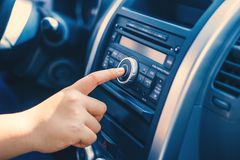 Man using car audio stereo system Royalty Free Stock Photos