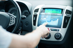 Man using car control panel Stock Images