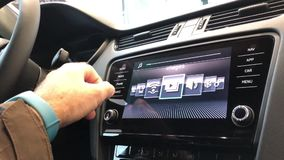 Man using car electronic display. PARIS, FRANCE - CIRCA 2017: Point of view of man using the new navigation dashboard touchscreen of a Skoda Volkswagen car - DAB stock video footage