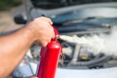 Man using car to extinguish a car fire. royalty free stock photo