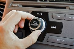 Man using car volume control. Royalty Free Stock Photography