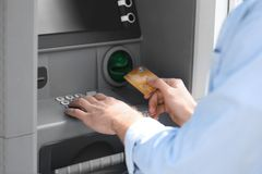 Man using cash machine for money withdrawal outdoors. Closeup royalty free stock photos