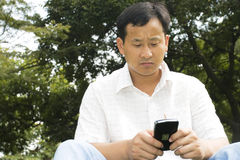 The man using cell phone Stock Photos