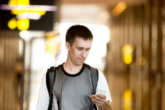 Man using cell phone in airport Royalty Free Stock Photo