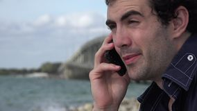 Man Using Cell Phone Near Bridge Overpass stock video
