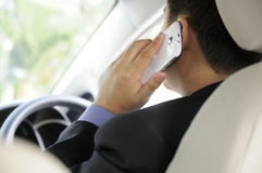 Man Using Cellphone While Driving Stock Photography