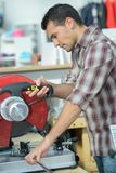 Man using circular saw in workshop stock photography