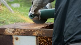 Man using a circular saw for processing metal construction Royalty Free Stock Images