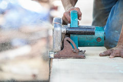 Man using a circular saw to cut the wood Royalty Free Stock Photography