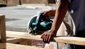 Man using circular saw on wood Royalty Free Stock Photo