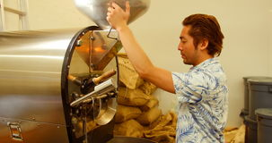 Man using coffee grinding machine. In coffee shop stock video