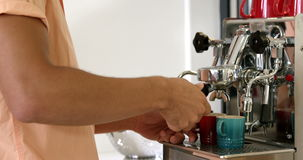 Man using a coffee machine. At home stock footage