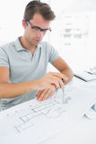 Man using compass on design Royalty Free Stock Images