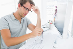 Man using compass on design Stock Image