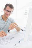 Man using compass on design Royalty Free Stock Image