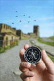 Man using a compass while sightseeing abroad Royalty Free Stock Images