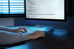 Man using computer in dark room. Criminal offence. Man using computer in dark room, closeup. Criminal offence royalty free stock photo