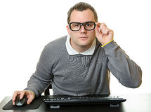 Man using computer at desk Royalty Free Stock Images