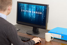 Man using computer with error. Man working on computer with error royalty free stock photo