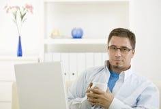Man using computer at home Stock Photo
