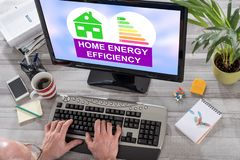 Home energy efficiency concept on a computer. Man using a computer with home energy efficiency concept on the screen royalty free stock photo