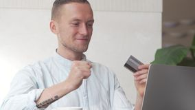 Man using computer for online purchase with credit card stock footage