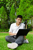 Man using computer outdoor Royalty Free Stock Image