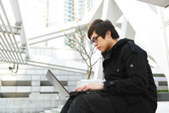 Man using computer outdoor Stock Photography