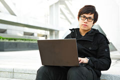 Man using computer outdoor Royalty Free Stock Photo