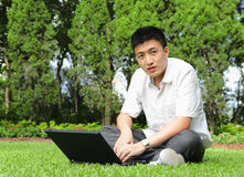 Man using computer outdoor Stock Photo