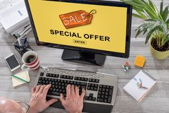 Special offer concept on a computer. Man using a computer with special offer concept on the screen Stock Images