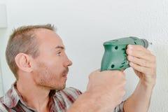 Man using cordless drill. Man using a cordless drill Stock Photos