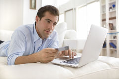 Man using credit card and laptop, shopping online Royalty Free Stock Image