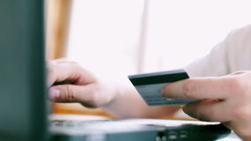 Man is using credit card for online payment. Man is using credit card and laptop  for online payment. FullHD video stock footage