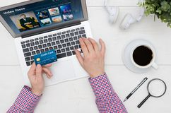 Man using credit card to pay for Video On Demand service Royalty Free Stock Image