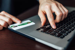 Man using credit card for web payment Royalty Free Stock Images